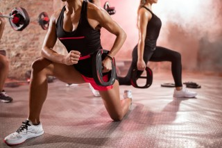 muscular people exercise with weights
